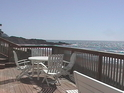 Outdoor seating on the living room deck with the view south down the coast.