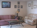First story recreation room with queen sofa sleeper, futon, reclining love seat, TV with DVD/VCR,